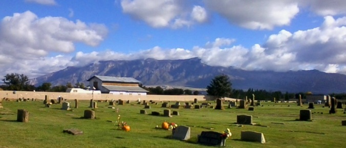 red cemetery and mountains 1